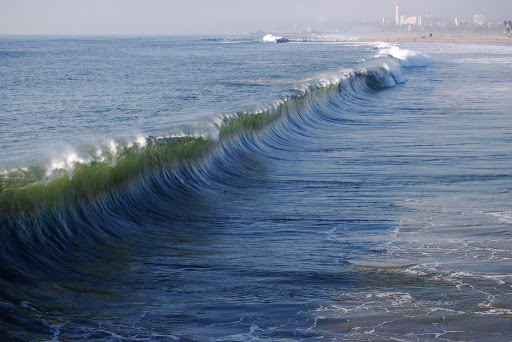 Giant tsunami wave approaching shore El Nino